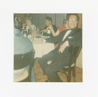 Three people sitting at a table at an event at the Willard Hotel [Photograph, Color] [Box 2, Black Photograph Box], circa 1970