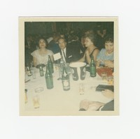 Leona Puyot Sevilla and three other people sitting at a table at an event at the Willard Hotel [Photograph, Color] [Box 2, Black Photograph Box], circa 1970