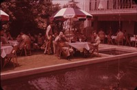 Outdoor café tables and fountain, undated