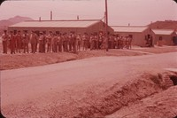 Barracks and a long line of soldiers, undated