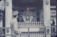 United States soldier examines the Statue of Tokugawa Ieyasu at the Tōshō Shrine in Nikkō, Japan, undated