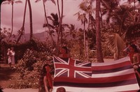 Three women holding a flag, Hawaii, undated
