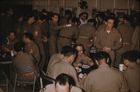 Soldiers eating cake, undated