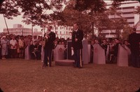 U.S. Army Field Band playing with Saxophone soloist and a singer in foreground, undated