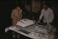 Chester E. Whiting cutting cake, undated