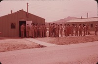 Line of soldiers outside barracks, undated