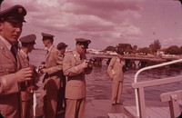 Six soldiers with cameras at harbor, undated