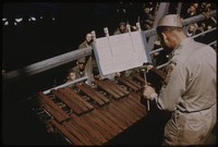 Marimba player performing on a ship, undated