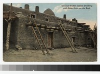 Unusual Pueblo Indian dwelling with bake oven on the roof, New Mexico, 1907-1914
