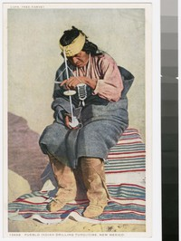 Pueblo Indian drilling turquoise, New Mexico, 1915-1930