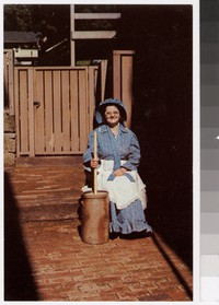 Woman with butter churner, Roscoe Village, Coshocton, Ohio, 1960-1980